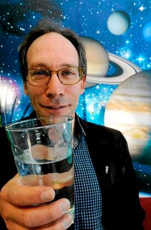 Theoretical physicist Lawrence Krauss with a glass of star stuff, aka water, at CSIRO Discovery Centre.
