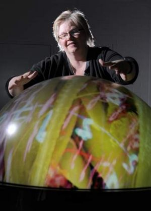 CSIRO Artist in Residence, Eleanor Gates-Stuart, in the interactive StellrScope exhibition at Questacon which is part of ...