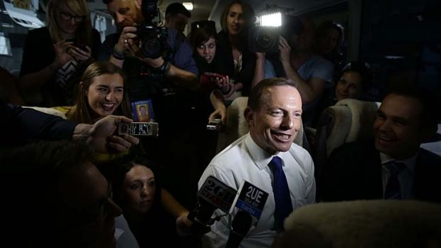Election 2013: Opposition Leader Tony Abbott speaks to media on the bus on the way to Ekka