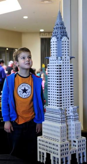 Brad Newman,6 of Queanbeyan takes a closer look at a Lego version of New York's Chrysler Building at Canberra Brick Expo ...