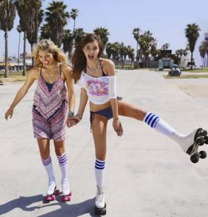 Cheeky and cheerful: Models Ashley Hart and Barbara Palvin at Venice Beach.