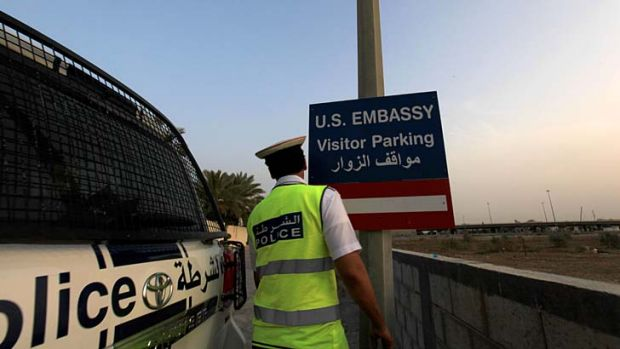 Set to re-open: A police officer on the road leading to the US Embassy in Bahrain, one of the many diplomatic posts ...