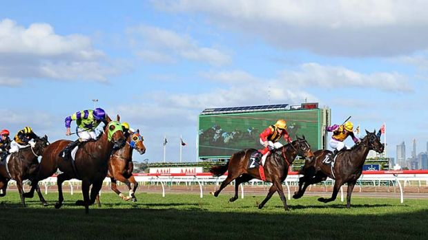 Luke Nolan rides Broken (left) to victory in the Aurie's Star Handicap ahead of Craig Williams on Temple of Boom and ...