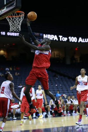 Talent to burn: Thon Maker goes to the hoop during the NBPA Top 100 Camp in June at John Paul Jones Arena in ...