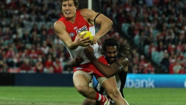 Pecking order: Kurt Tippett is tackled by Harry O'Brien.