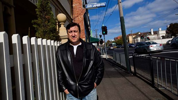 Punt Road resident and action group spokesman Andrew Carrasco outside his property.