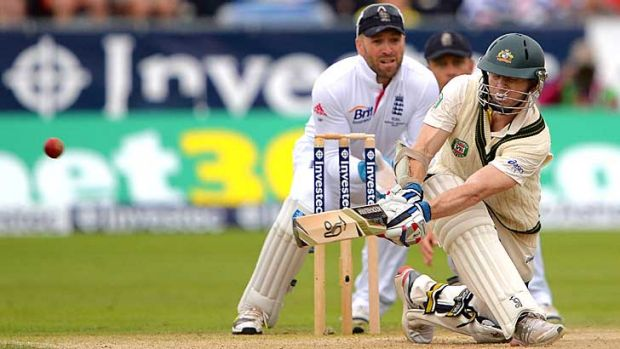 Cliffhanger: Chris Rogers brings up his maiden Test century with a sweep shot against Graeme Swann.