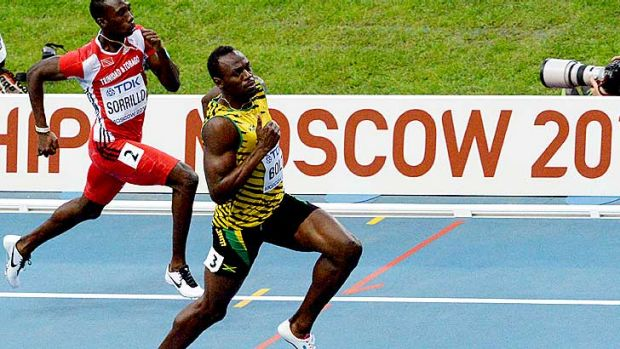 King of the sprints: Usain Bolt eased his way through the heats of the 100 metres.