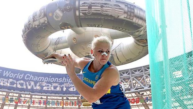 Broken and beaten: Natalia Semenova competed in the qualifying round of the discus with a broken nose.