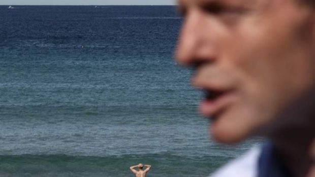 Opposition Leader Tony Abbott defends his spending and savings measures at Bondi Beach, Sydney, on August 11.