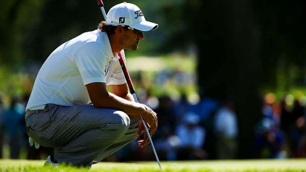 Adam Scott lines up a putt during the third round of the 95th PGA Championship on Saturday.