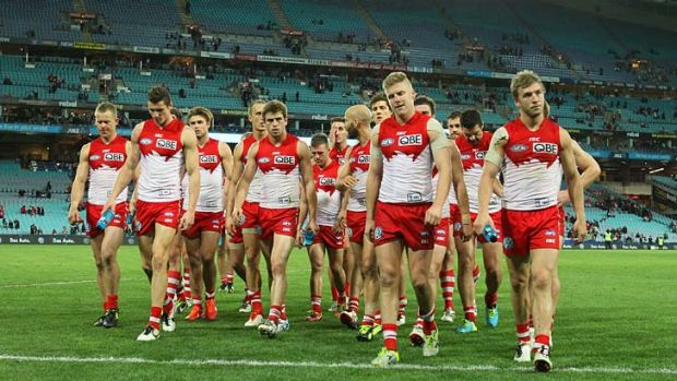 The Sydney Swans leave the ground after losing 100-71.