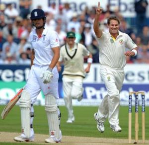 Ryan Harris celebrates after taking the wicket of England captain Alastair Cook.
