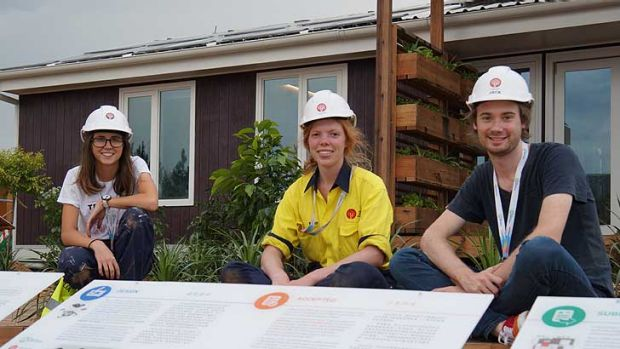 The house that Chelsea Cook, Fiona Hudson, Jack Breen (left to right) and 48 other students built.