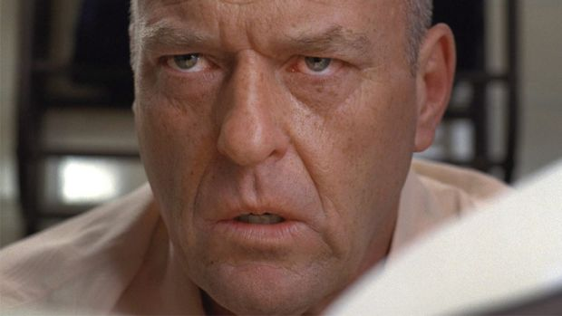 "The secret is out: Hank Schrader (Dean Norris) knows his brother-in-law is the notorious ""W.W""."
