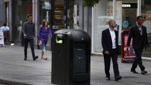 Officials say that an advertising firm must immediately stop using its network of high-tech rubbish bins, like this one, ...