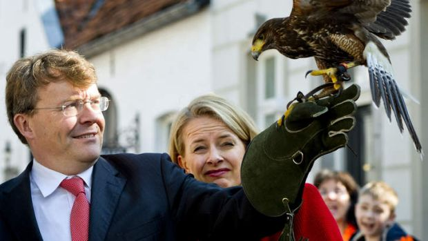 Dutch Prince Johan Friso holding a desert hawk during Queen's day in 2011.