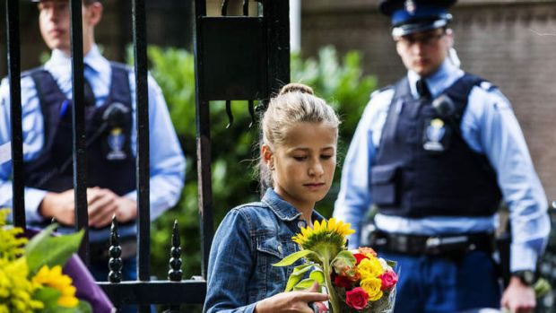 Guards receive flowers in memory of Prince Friso at the gates of Palace Huis ten Bosch, in The Hague, Netherlands.