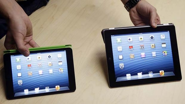 Apple's iPad mini, left, and iPad. Both are said to be getting a revamp.