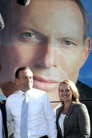 Best foot forward: Opposition Leader Tony Abbott and Liberal candidate Fiona Scott in Penrith on Tuesday.