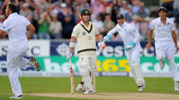 David Warner looks on as (from left) Tim Bresnan, Matt Prior and Alastair Cook celebrate his dismissal during day four ...