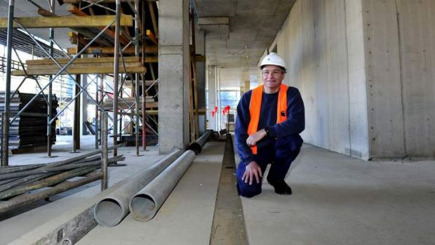 Brewer Richard Watkins  inside the premises of what will become his new two-level brewpub BentSpoke Brewing Company, Braddon.