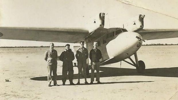 Reg Kupsch is the man standing closest to the plane in the group shot. Names of others are not known.