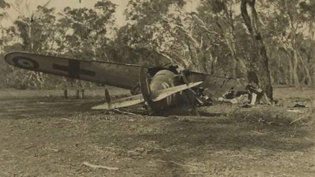A rare picture of the plane crash at Mount Ainslie.