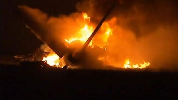 Flames rise from a UPS Airbus A300 cargo plane which crashed near the airport in Birmingham, Alabama.