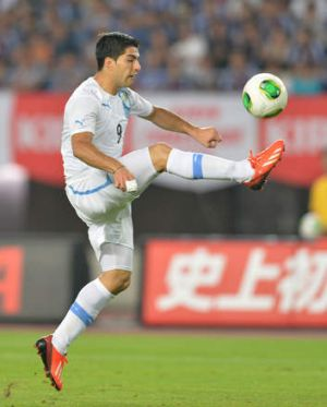 Luis Suarez playing for Uraguay against Japan overnight.