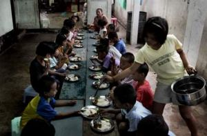 Dig in, don't wait … lunchtime at the children's boarding house next to the Mae Tao Clinic's safe house for women.