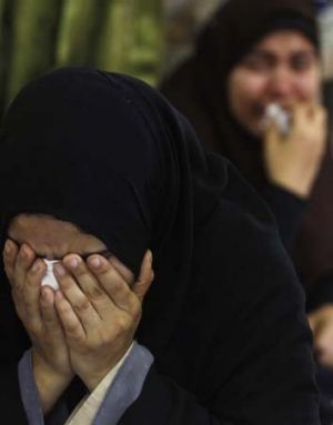 Tears for the dead: Relatives of dead members of the Muslim Brotherhood cry at a mosque in Cairo.