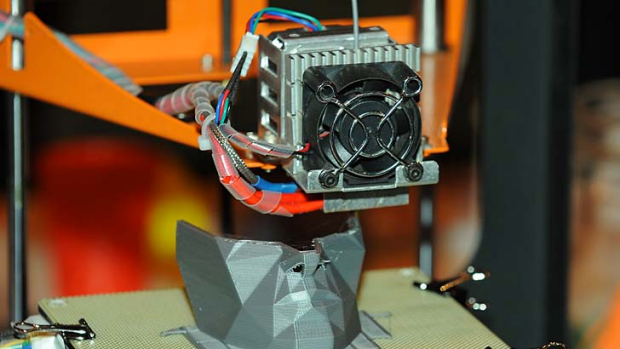 A 3D printer on display at Gadget Show Live 2013 in Birmingham, Britain.