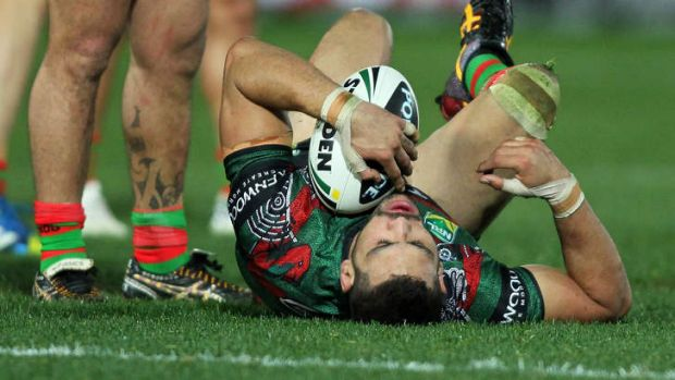 Greg Inglis lies on the ground after a hit that was judged high from Justin Horo.