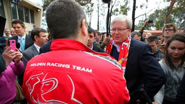 Prime Minister Kevin Rudd meets Holdern workers at a barbecue in Adelaide after announcing extra funding for the car ...