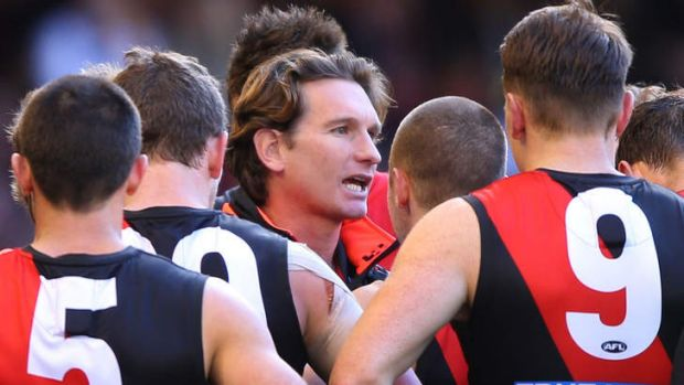 Bombers coach James Hird speaks to his players.