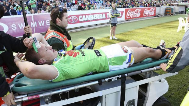 Season over: Raiders winger Jack Wighton was stretchered off with a suspected broken ankle.