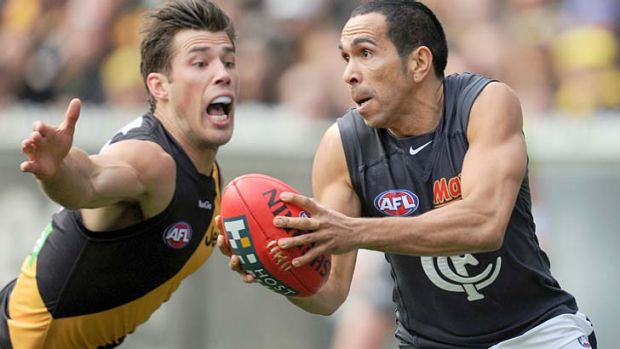 Desperate times: Tiger Alex Rance tries to smother the ball as Carlton's Eddie Betts looks to get a handpass away at the MCG.