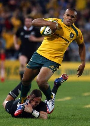 On the mark: Wallabies' Will Genia avoids a tackle before scoring for the Wallabies.