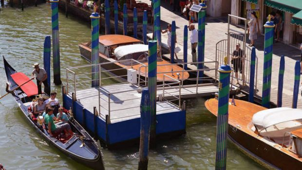 People look at the site of a boat accident in Venice where a German tourist was killed.