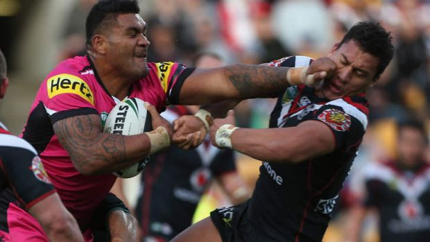 Bruising encounter: Mose Masoe of the Panthers fends off Elijah Taylor of the Warriors.