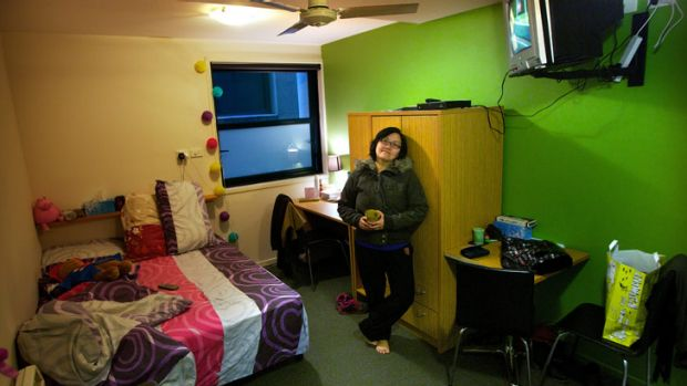 Chef Josephine Lee, 37, in her 'micro apartment' in Flinders Street. She pays $300 a week for 11.2 square metres of ...
