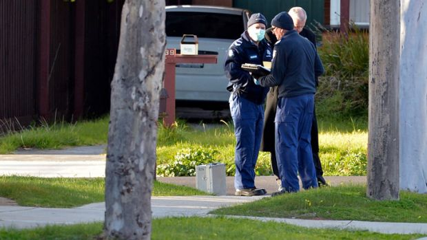 Police in Strang Street in Hoppers Crossing, where a body has been found on the footpath.