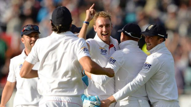 Got him: England's Stuart Broad celebrates after taking the wicket of Brad Haddin during the fourth day of the fourth ...