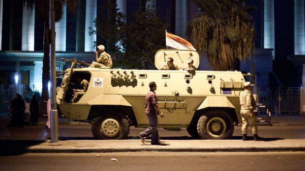 An Egyptian army armoured vehicle is seen in front of the Supreme Constitutional Court in Cairo ahead of planned ...
