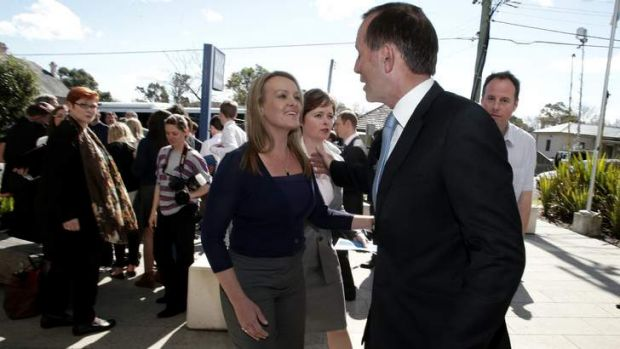 Tony Abbott and Liberal candidate Fiona Scott visit the St Marys police station in western Sydney on Monday.