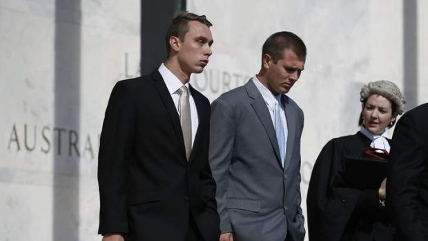 Former ADFA cadets Dylan Deblaquiere, left, and Daniel McDonald, centre, leave the ACT Supreme Court after appearing in ...