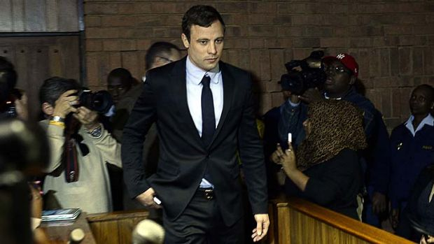 Back in court: South African Olympic sprinter Oscar Pistorius at the Magistrates Court to hear charges over his ...