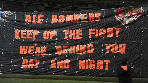 Sorry sign: Essendon's banner against North Melbourne on Saturday.