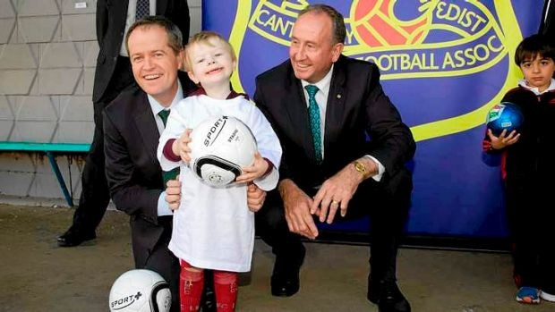 Three amigos: Minister Bill Shorten, left, and member for Reid John Murphy with Oliver Lucas, 2, at Concord.